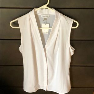 Calvin Klein. White Silky sleeveless blouse